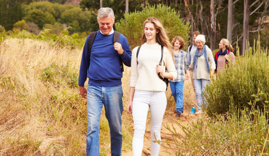 family walking on a trail